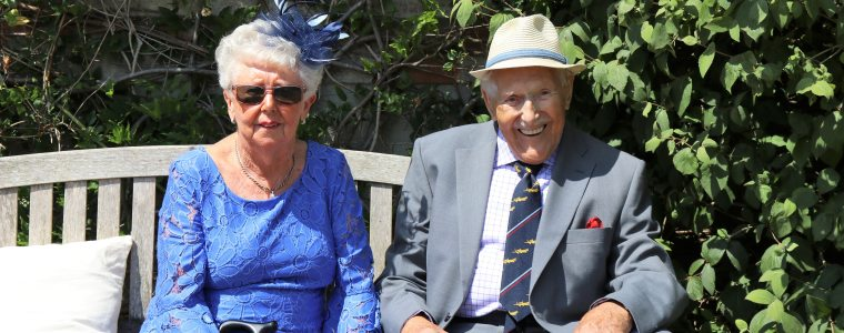 happy elderly couple sitting on a bench