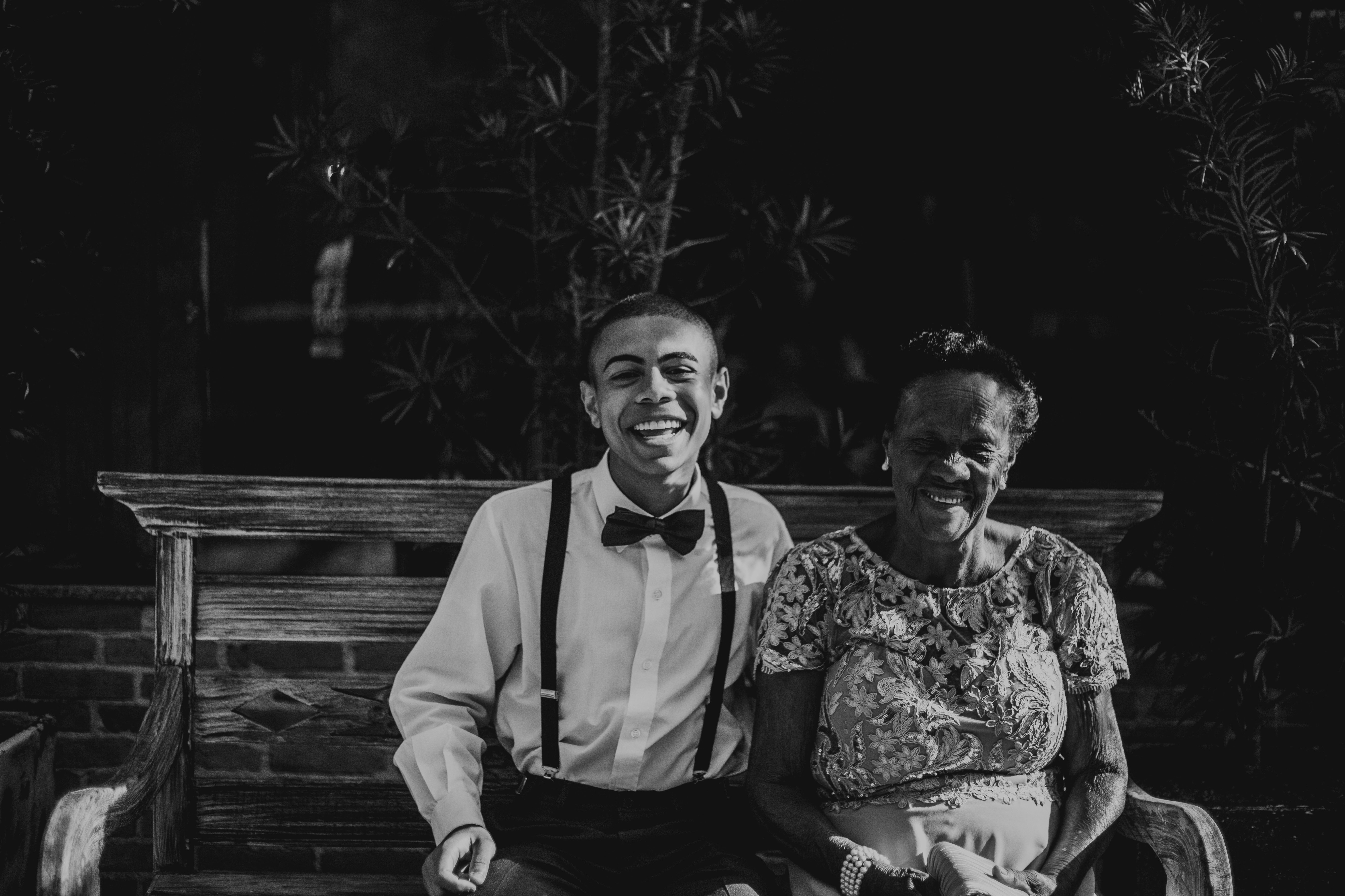 happy elderly woman with younger male relative