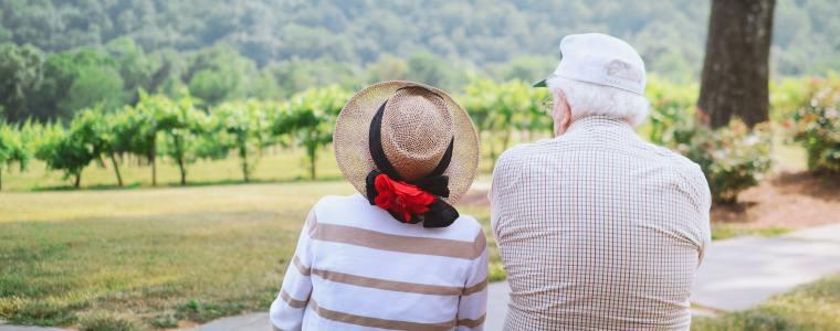 senior couple sitting on mountainside