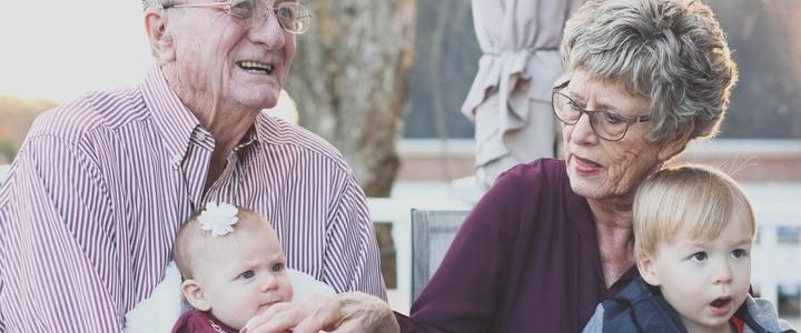 grandparents holding grandchildren